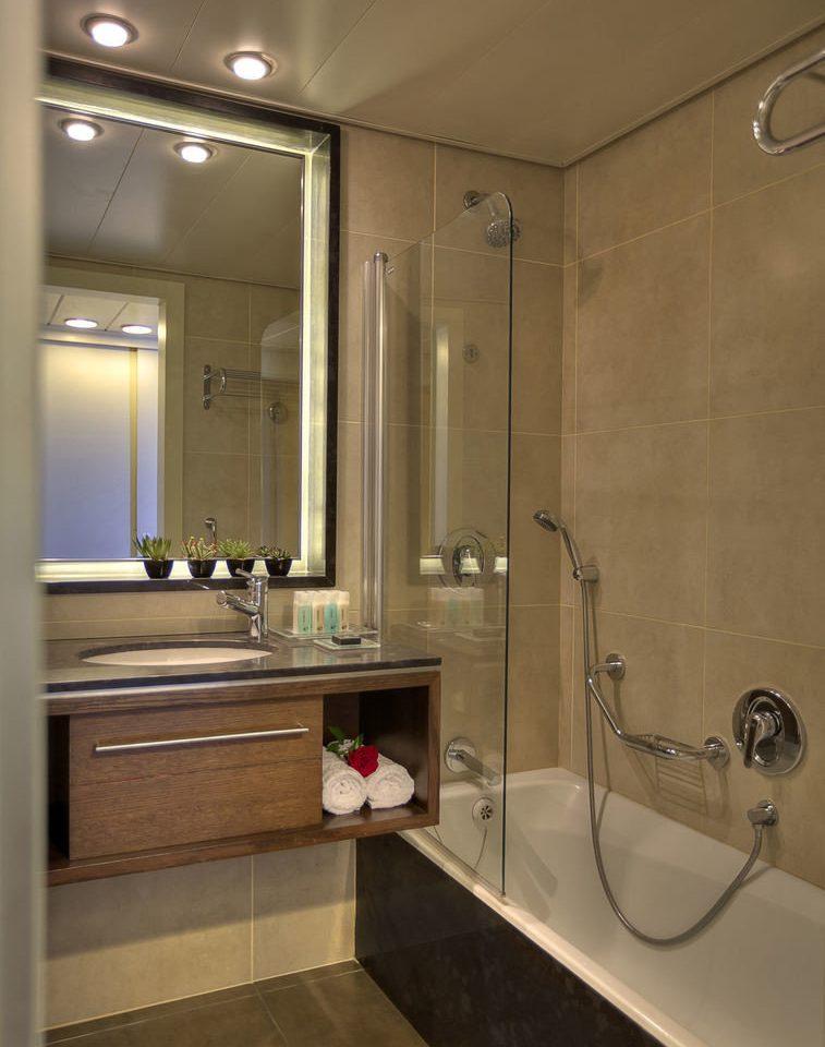 bathroom property sink home cabinetry shower flooring toilet plumbing fixture Suite tub tile clean bathtub Bath Modern tiled