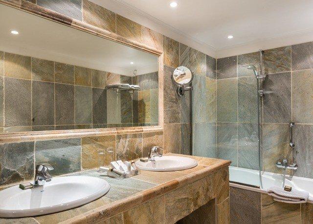 bathroom sink mirror large property double Suite vessel tile toilet tub tiled Bath bathtub water basin Modern tan