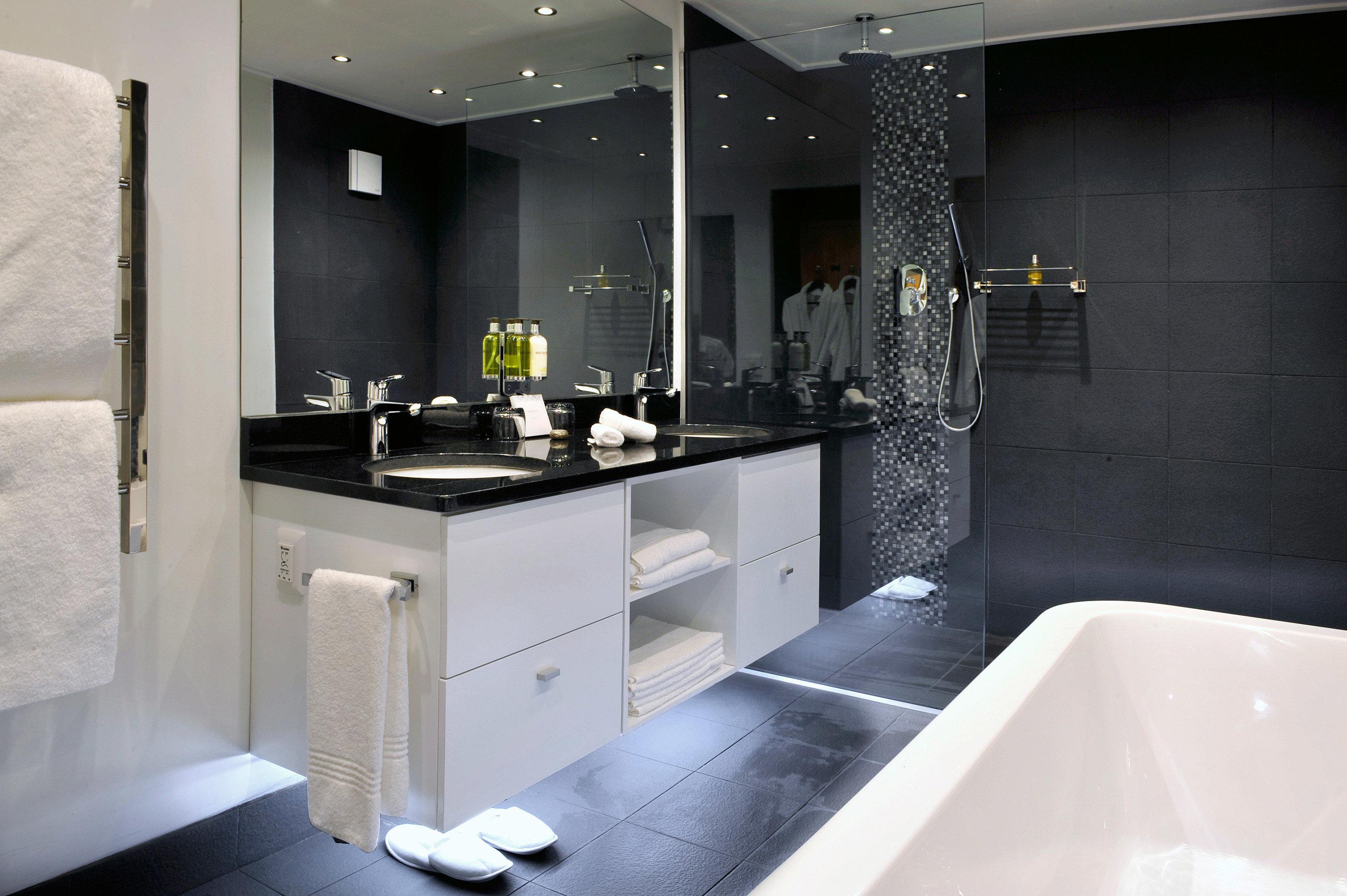 bathroom property sink toilet home plumbing fixture white counter Suite bathtub bidet flooring Modern Bath