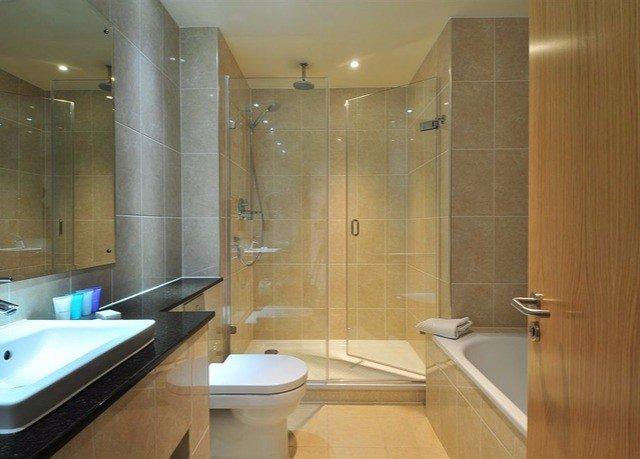 bathroom shower property sink glass Suite plumbing fixture tub clear Modern bathtub Bath clean tile