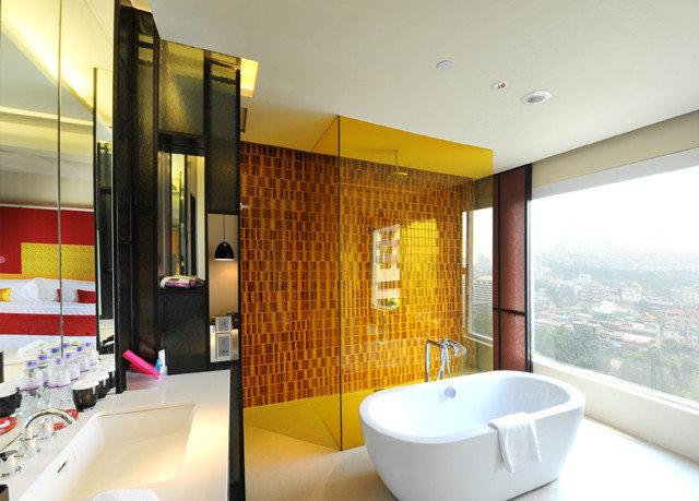 property bathroom Suite condominium swimming pool Modern tub Bath bathtub
