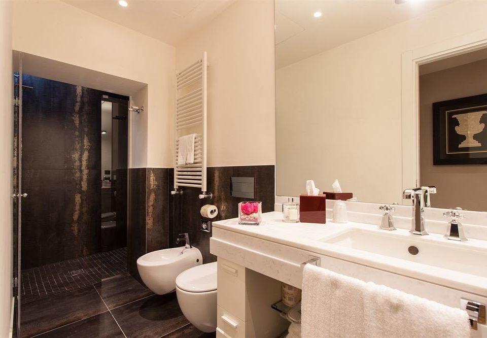 bathroom mirror sink property Suite towel home condominium toilet Modern tub tile Bath bathtub