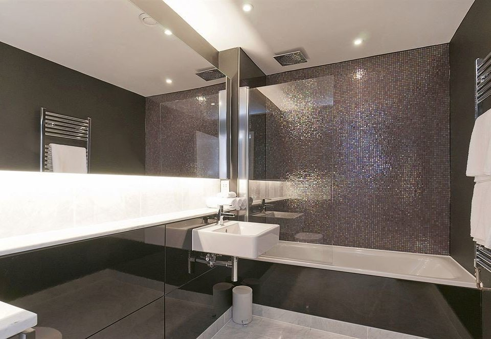 bathroom property sink counter plumbing fixture Suite bathtub flooring Modern tile tub tiled Bath