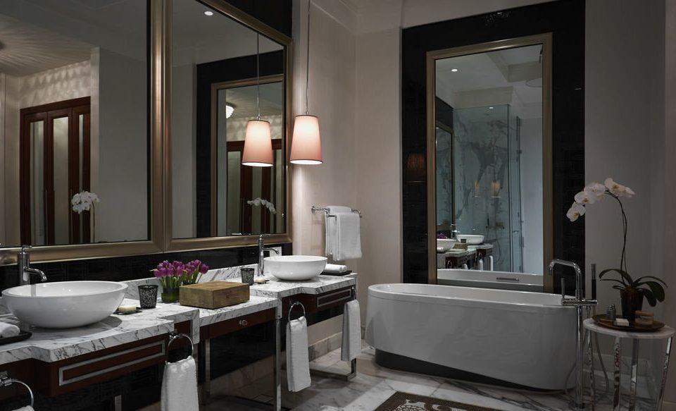 bathroom mirror sink property home lighting Suite living room cabinetry towel tub bathtub Modern Bath