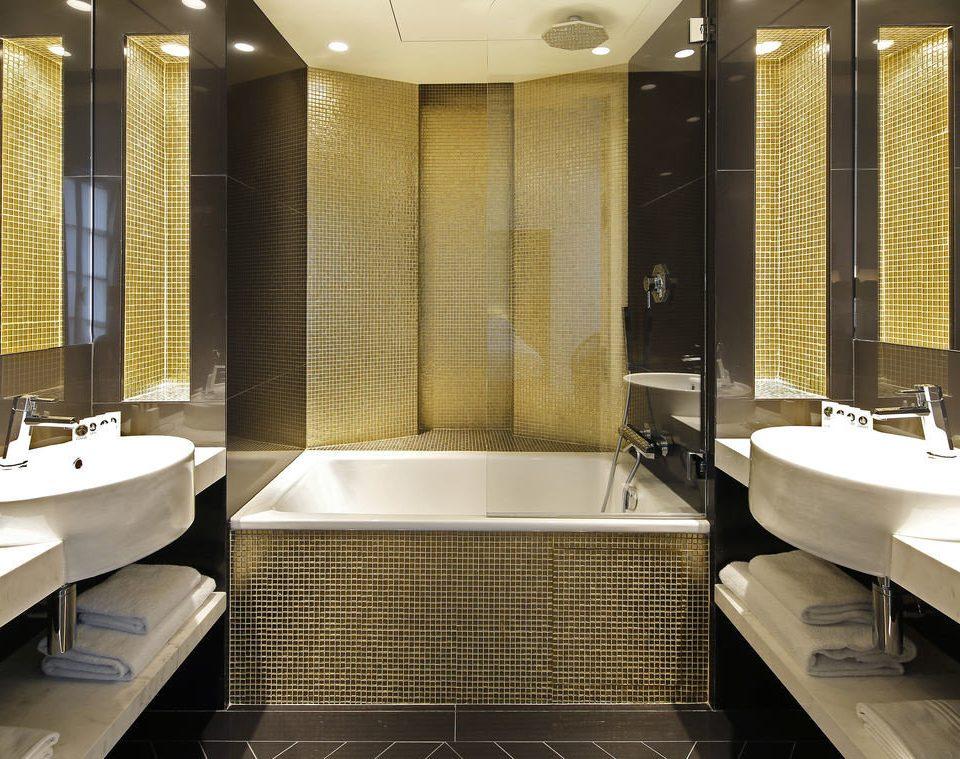 bathroom sink Suite swimming pool bathtub tub plumbing fixture flooring toilet Modern tiled Bath