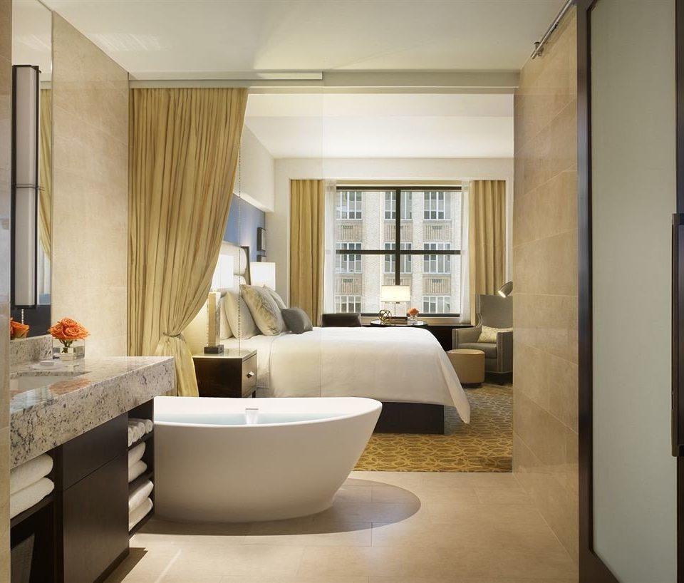 property bathroom home condominium Suite living room flooring tub Modern Bath bathtub