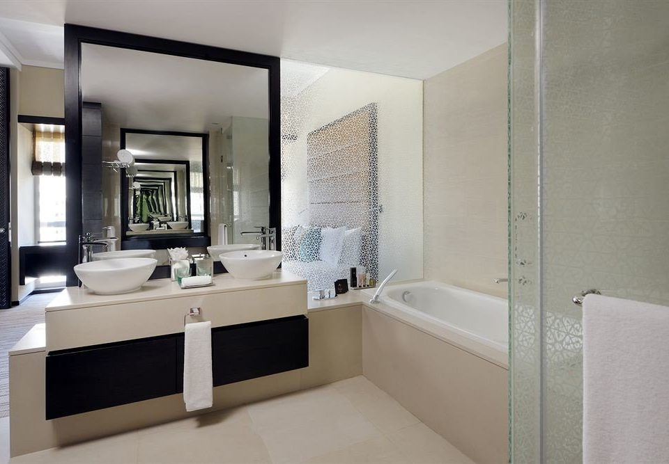 bathroom mirror property sink white home plumbing fixture Suite bathtub flooring condominium tub Modern Bath