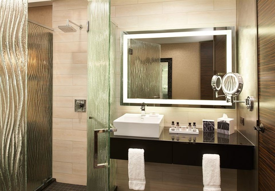 bathroom mirror sink property towel home lighting shower flooring plumbing fixture cabinetry Suite Modern tile Bath