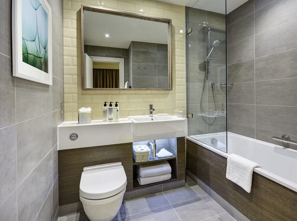 bathroom property sink toilet home public toilet Suite plumbing fixture flooring bidet tiled tile Modern tub Bath bathtub