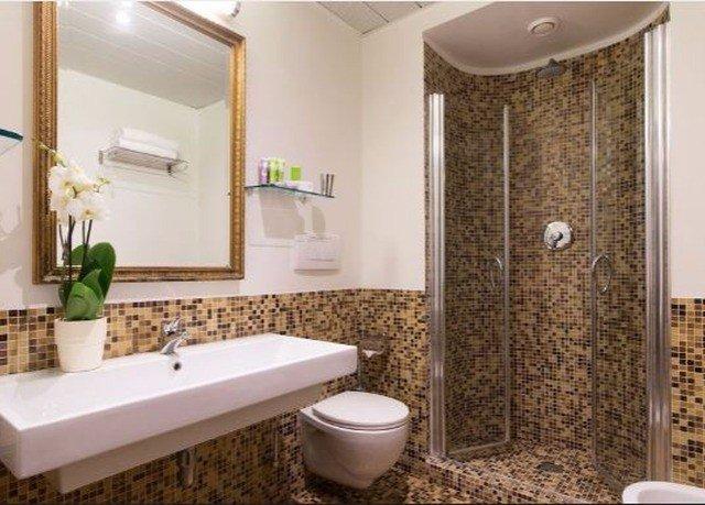 bathroom sink property toilet flooring plumbing fixture Suite shower tile tub bathtub tiled Modern Bath