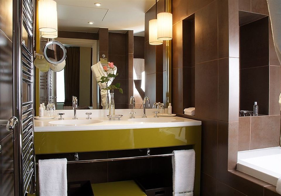 bathroom mirror sink property Suite home tub bathtub Bath Modern tile tiled