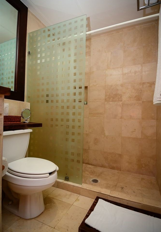 Bath Modern Tropical Waterfront bathroom toilet property plumbing fixture flooring bathtub tile tiled