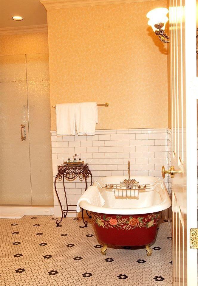Bath Resort bathroom bathtub plumbing fixture flooring tiled