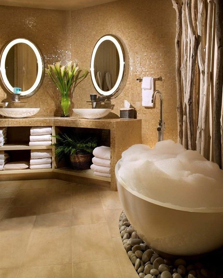 Bath Resort bathroom flooring living room home tile plumbing fixture sink