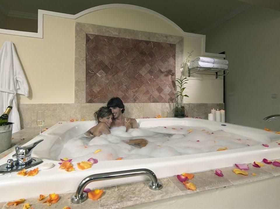 Resort swimming pool sink jacuzzi bathtub Bath cluttered