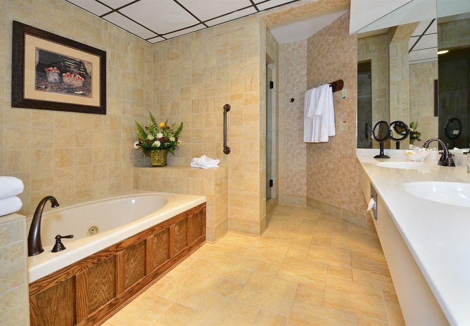 Bath Resort Romantic bathroom property sink home hardwood flooring countertop tub cabinetry cottage Suite wood flooring bathtub tile
