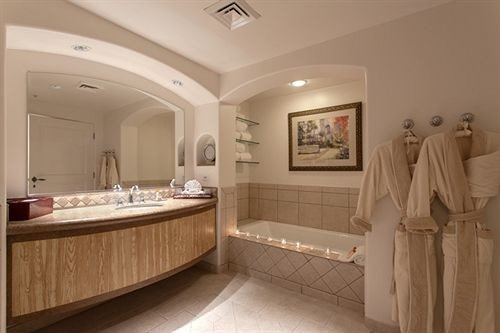 Bath Resort bathroom property sink Suite tub bathtub mansion tile tan