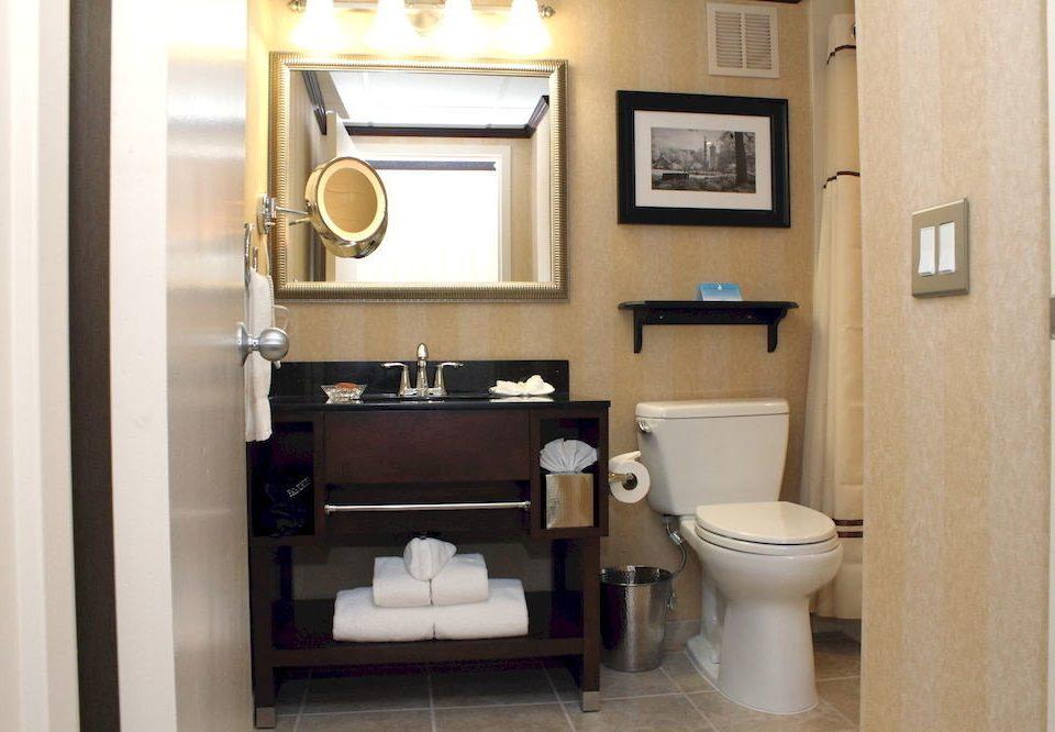 Bath Romantic bathroom toilet mirror property sink home Suite cottage plumbing fixture rack tan