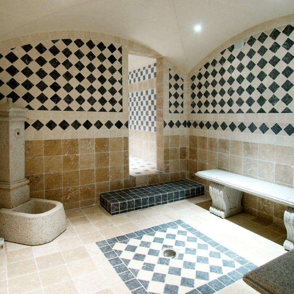 Spa bathroom tiled tile swimming pool property tub sink flooring plumbing fixture jacuzzi bathtub Bath stone