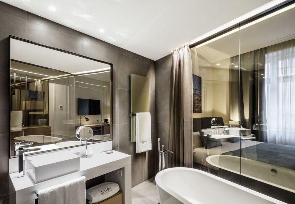 bathroom sink mirror property condominium home toilet Suite counter living room tub Bath appliance bathtub