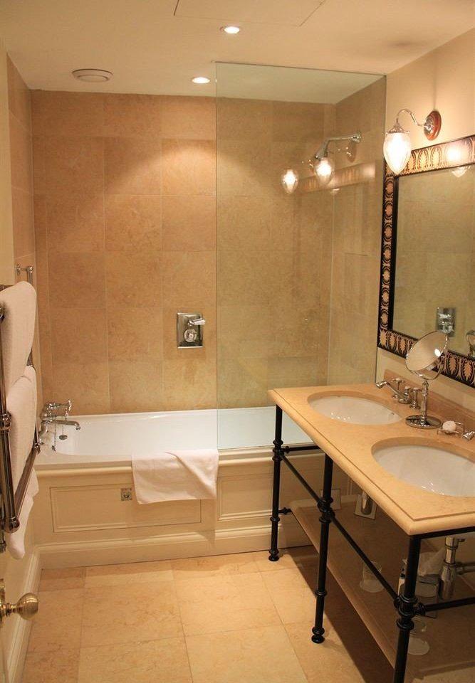 bathroom sink property home plumbing fixture Suite toilet flooring basement tile tub bathtub Bath tiled