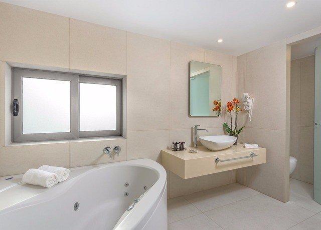 bathroom sink mirror vessel property home bathroom accessory plumbing fixture tile tub Suite bathtub Bath