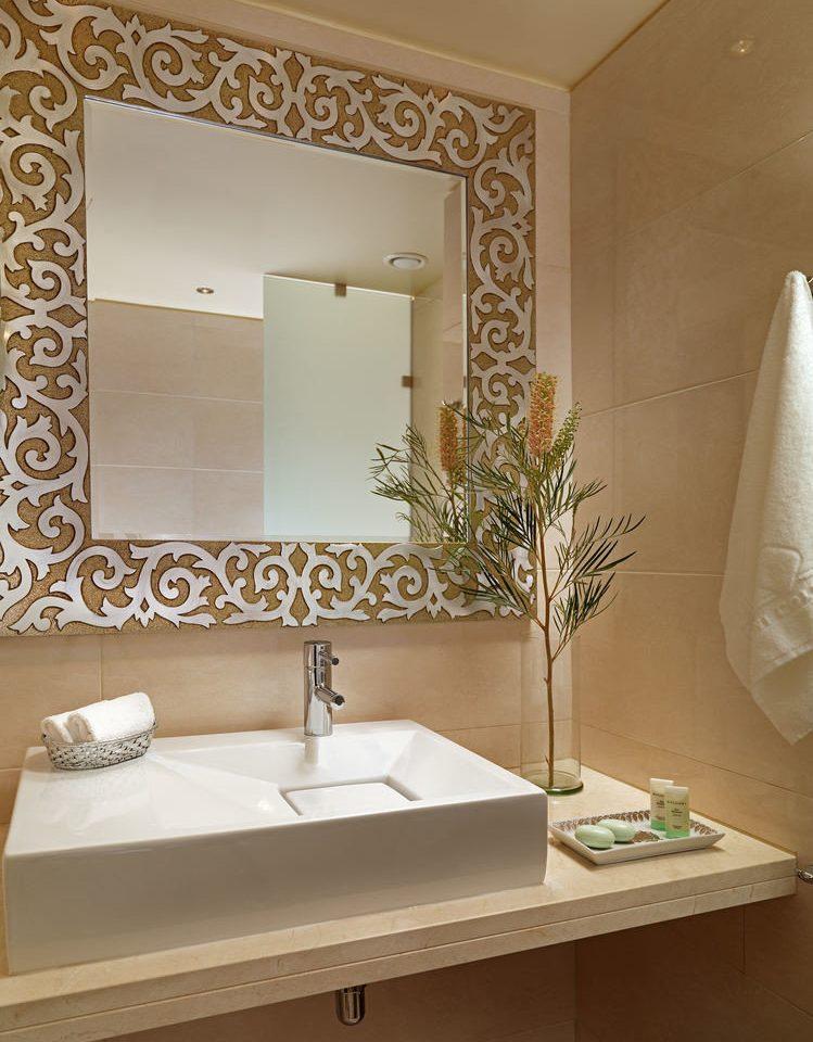 bathroom mirror sink towel vanity plumbing fixture bathtub flooring home Suite tile bathroom cabinet living room Bath fancy tub