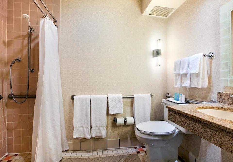 bathroom property towel sink Suite shower home cottage plumbing fixture flooring rack tub Bath tile bathtub tan