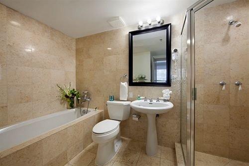 bathroom property toilet shower sink Suite plumbing fixture bidet tub Bath tan bathtub tiled