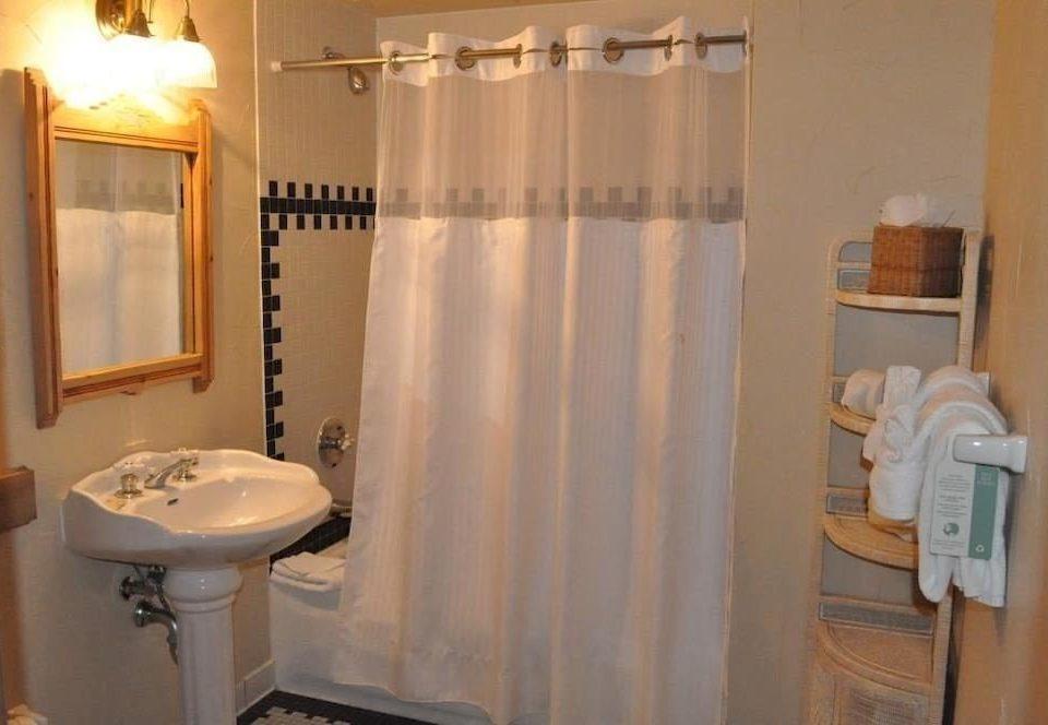 bathroom property sink white plumbing fixture curtain toilet Suite cottage tub Bath bathtub