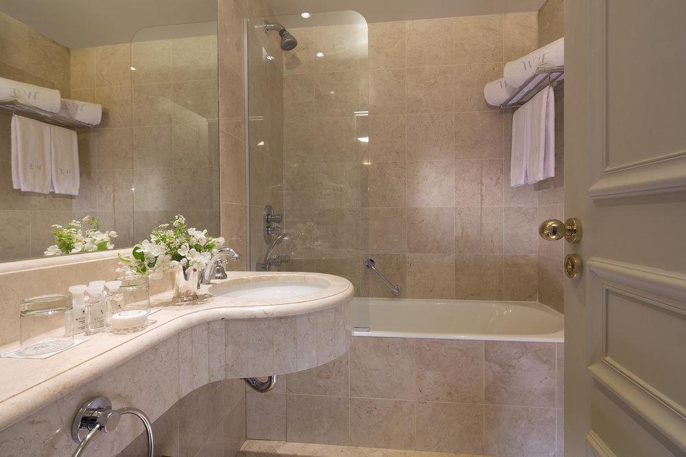bathroom sink property tub home toilet countertop bathtub flooring Suite plumbing fixture Bath tile tiled