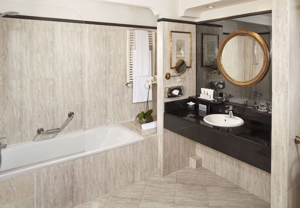 bathroom property sink bathtub home plumbing fixture Suite vessel cottage tub tile Bath tiled