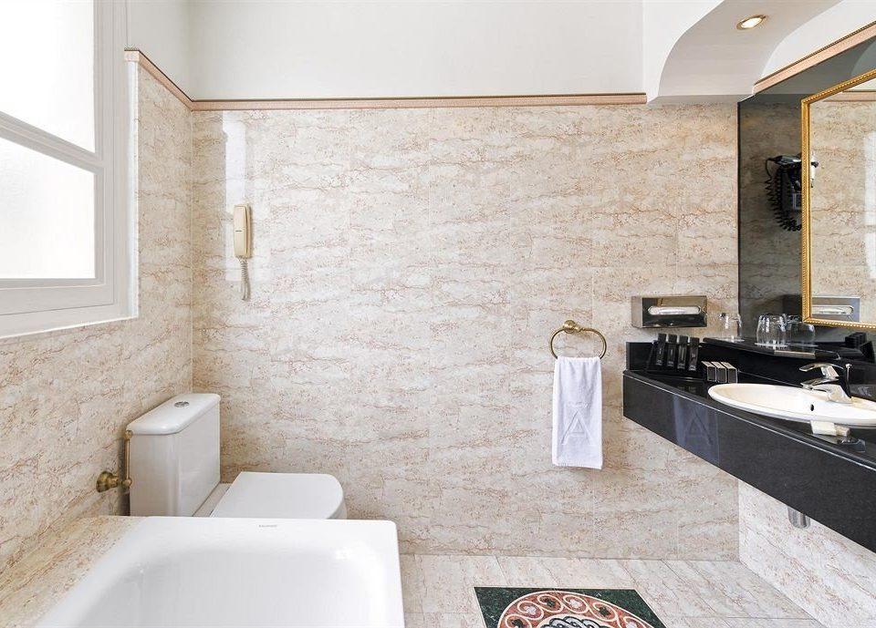 bathroom property sink flooring tile countertop home Suite bathtub plumbing fixture tiled Bath