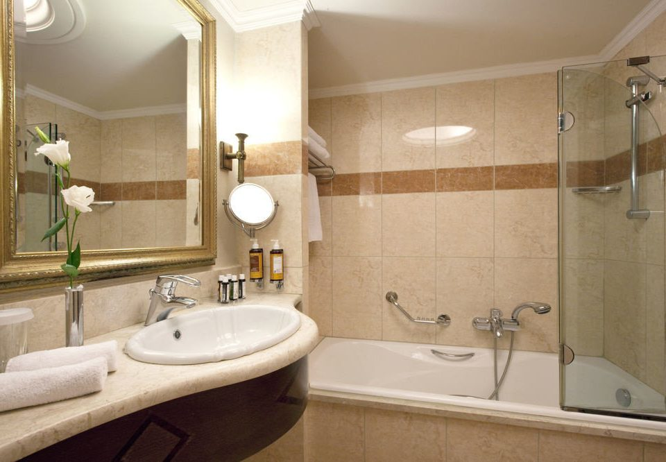 bathroom sink property mirror home Suite toilet vessel bathtub tub Bath tile tan