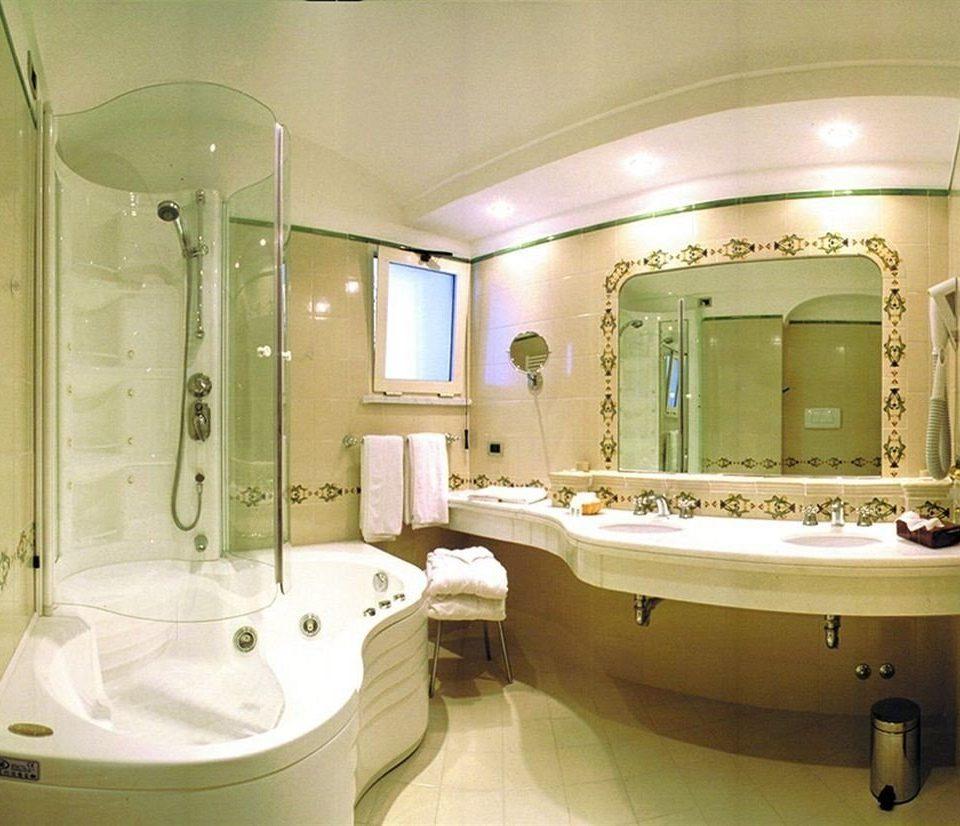 bathroom mirror sink property bathtub swimming pool tub toilet Suite plumbing fixture jacuzzi Bath tile tiled tan