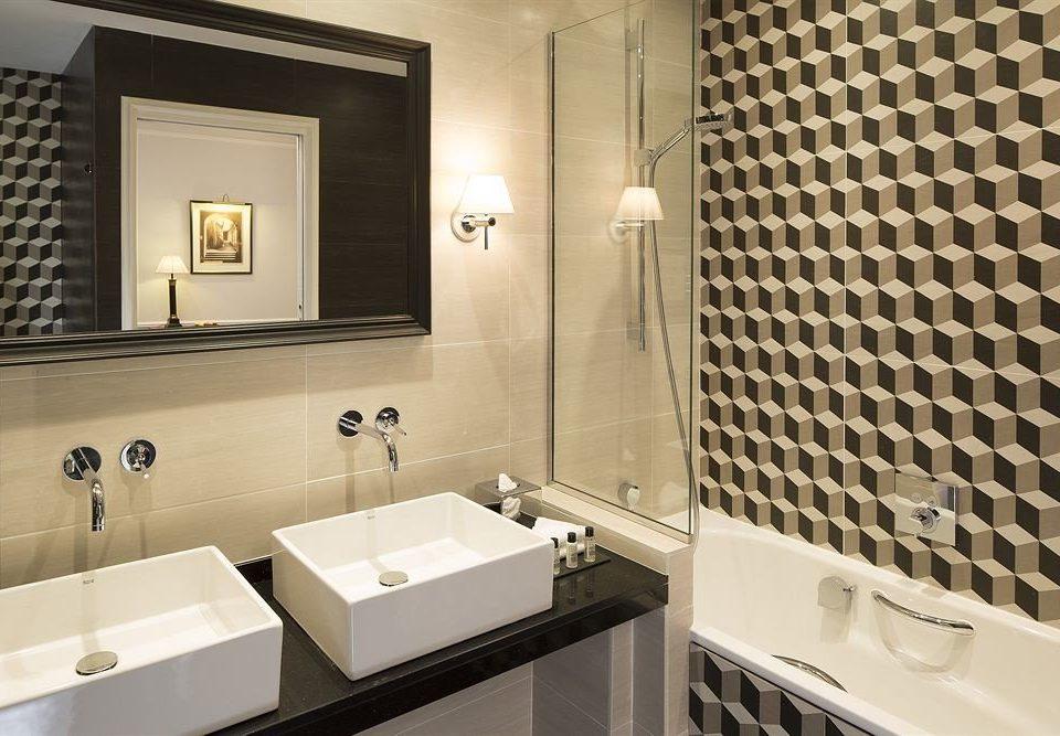 bathroom sink mirror property toilet white Suite tile flooring plumbing fixture tiled bathtub tub Bath