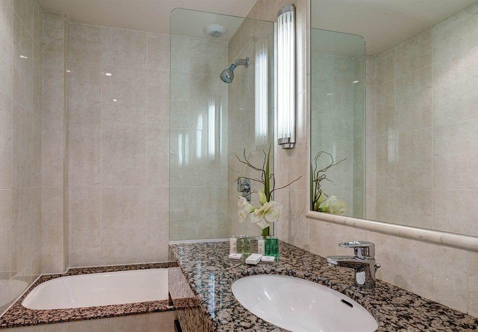 bathroom sink mirror property toilet shower tiled bathtub swimming pool plumbing fixture tile Suite flooring tub clean Bath