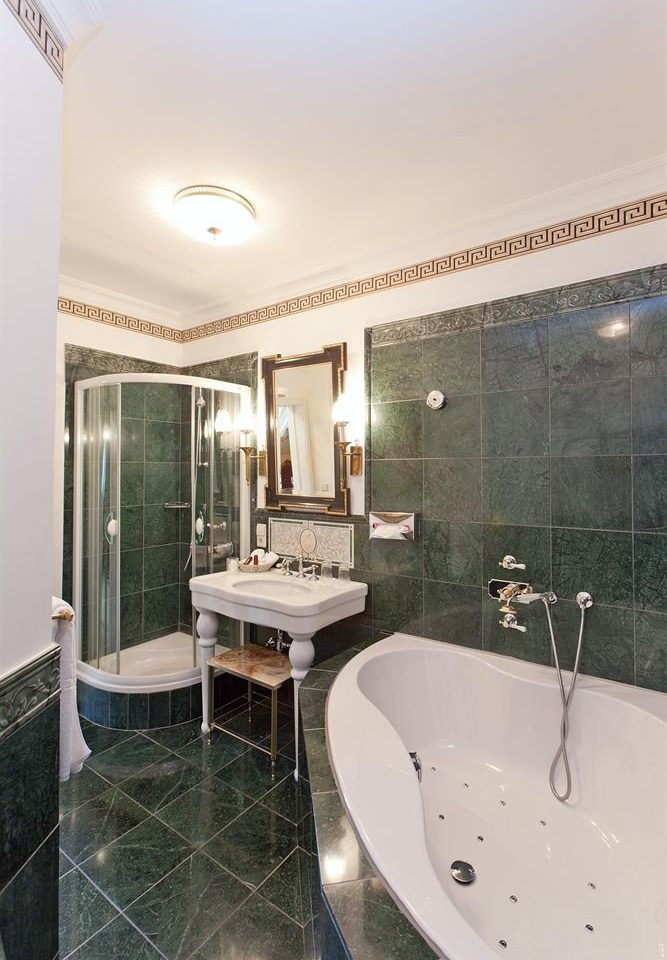 bathroom property sink shower swimming pool tub tiled home Suite Bath tile bathtub daylighting flooring