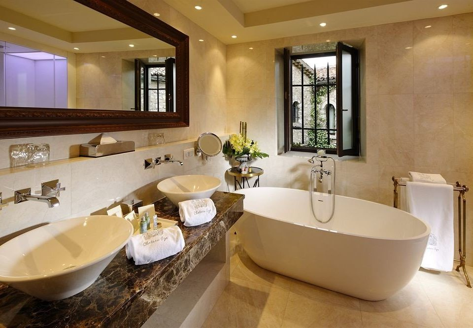 bathroom sink property mirror tub home Suite bathtub Bath toilet