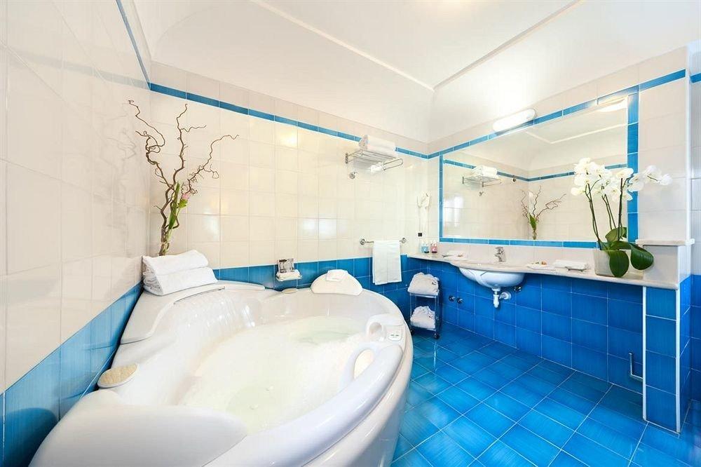 bathroom swimming pool property blue sink toilet bathtub Suite tub tile tiled Bath