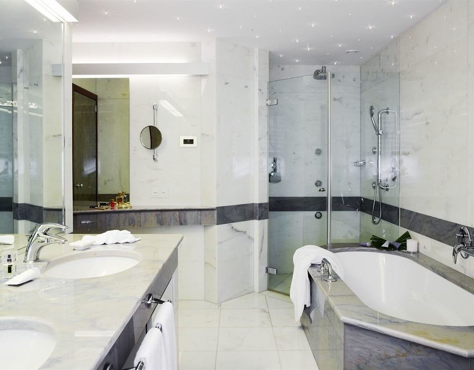 bathroom sink toilet property mirror bathtub plumbing fixture swimming pool flooring Suite bidet Bath tiled