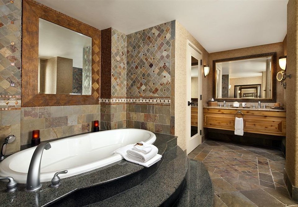 bathroom property flooring home hardwood sink Suite mansion living room tub stone Bath bathtub tiled