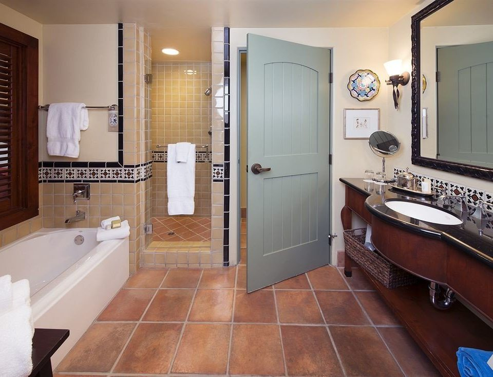 Bath bathroom property sink Suite hardwood home flooring bathtub cottage tile tub tiled
