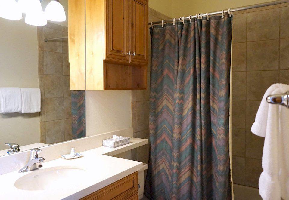 bathroom sink property shower plumbing fixture towel Suite tile cottage curtain tan tub bathtub Bath tiled