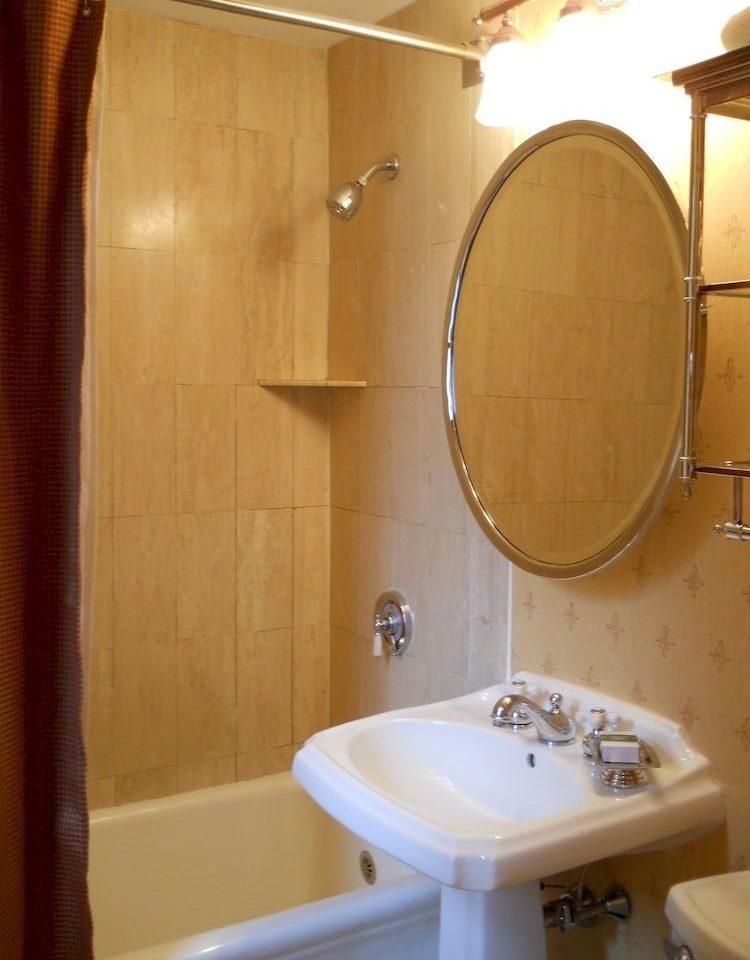 bathroom property white plumbing fixture Suite toilet swimming pool bathtub tub tile Bath tiled