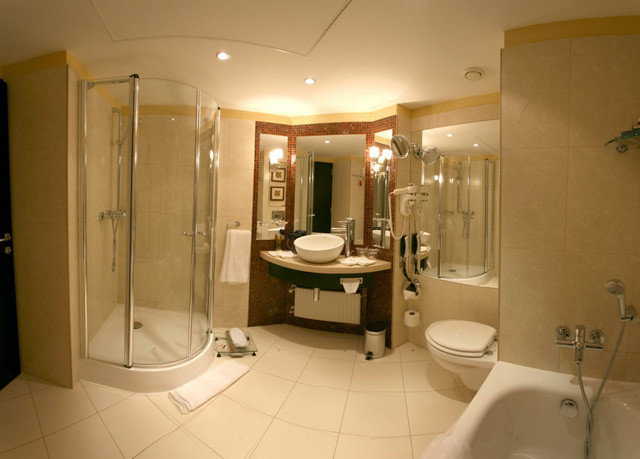 bathroom property sink toilet plumbing fixture Suite bathtub public toilet Bath tiled