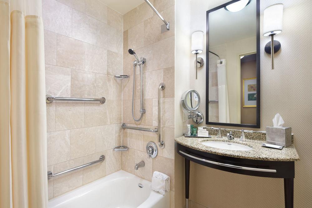 bathroom property toilet sink home vessel plumbing fixture Suite tub bathtub Bath tile tan