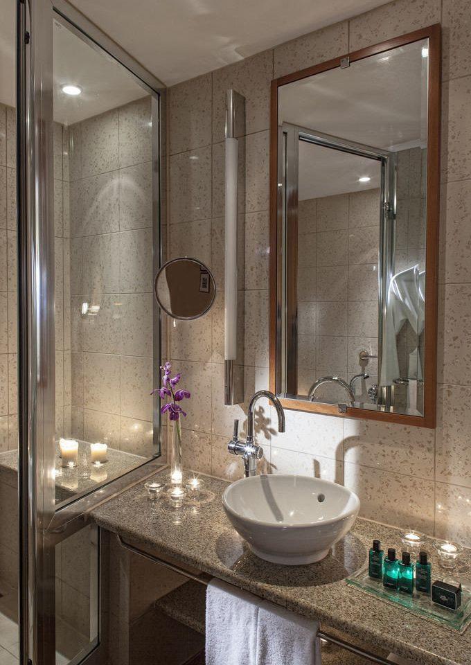 bathroom sink mirror plumbing fixture Suite flooring Bath tub cabinet bathtub