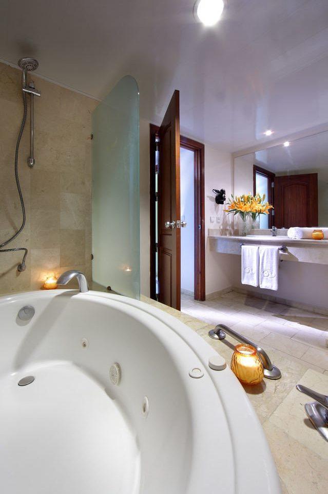 bathroom property house home white swimming pool bathtub Suite jacuzzi countertop toilet Bath tub tile