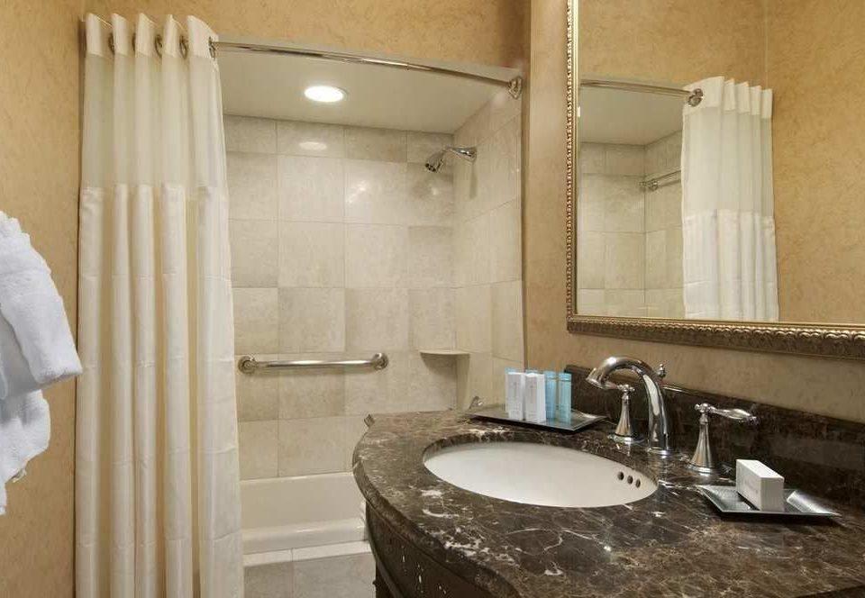 bathroom sink property toilet home Suite towel plumbing fixture tub Bath bathtub